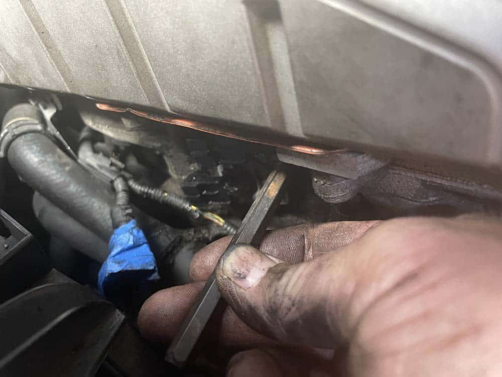 Align the mounting hole before installing the bolt