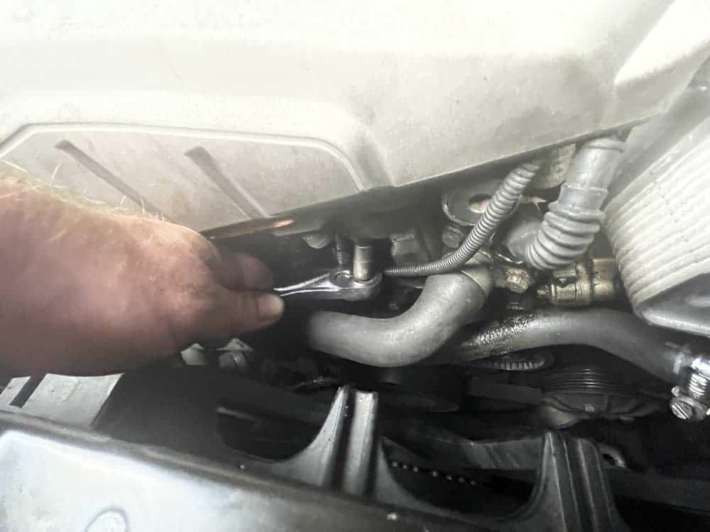 Remove the intake sensor mounting bolt