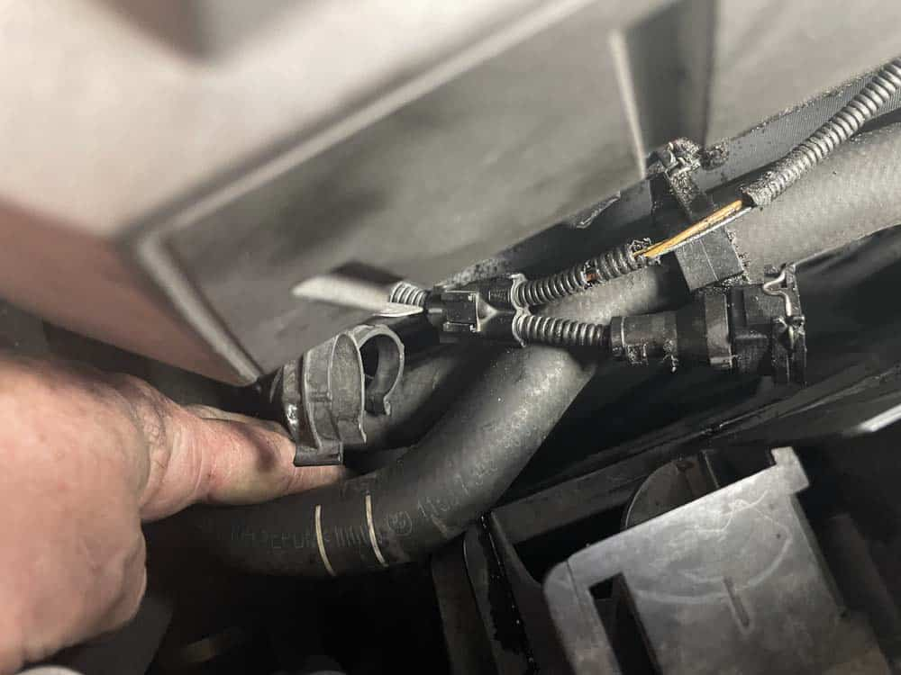 Move any coolant lines out of the way of the exhaust camshaft sensor